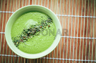 Raw soup with avocado, green peas, spinach and spices for healthy diet, food delivery service and order online