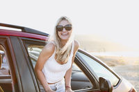 Joyful woman enjoying nature during road trip in evening