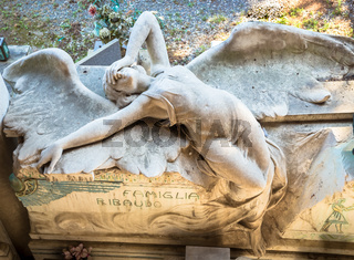 Statue of angel on a 1910 tomb located in an old Italian cemetery