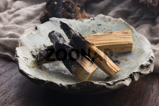 Smudging ceremony using Peruvian Palo Santo holy wood incense stick