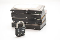 Computer hard disks and metal padlock symbolizing concept for encrypted data, cyber security on white background