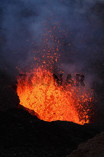 Night eruption volcano, fountain red hot lava erupting from crater