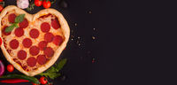 Pizza heart shaped with pepperoni