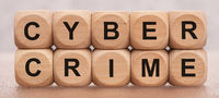 cyber crime printed on wooden cubes