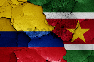 flags of Colombia and Suriname painted on cracked wall