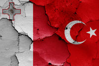 flags of Malta and Turkey painted on cracked wall