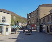 weavers square in the centre of hebden bridge surrounded by shops and cafes with no people
