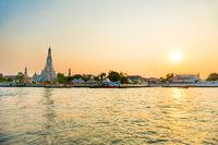 Temple of Dawn or Wat Arun in Bangkok at sunset