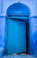 Half-open blue door in Chefchaouen, Medina, Morocco
