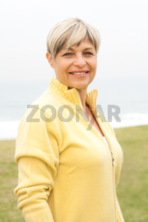 Beautiful aged woman in the park