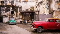Classical Vintage Cars Parked in an Old Cuban Building