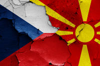 flags of Czech Republic and North Macedonia painted on cracked wall