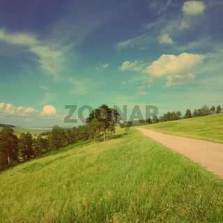 summer landscape with road - vintage retro style