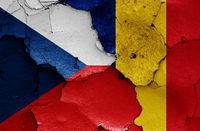 flags of Czech Republic and Romania painted on cracked wall