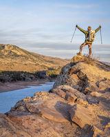 male hiker on a cliff overlooking Horsetooth Reservoir