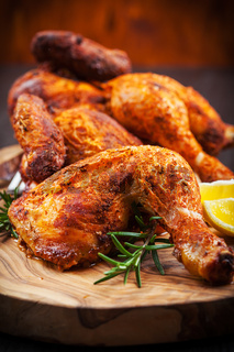 Tasty baked chicken with herbs and lemon