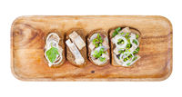 top view of various open sandwich with herring