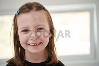 little girl without tooth smiling