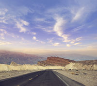 Desert road leading through Death Valley National Park, California USA.