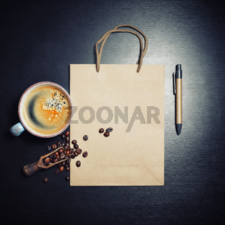 Paper bag, coffee, pen