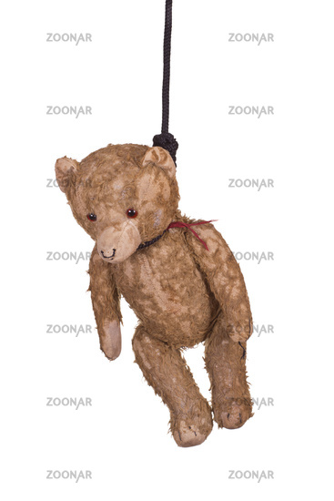 old teddy bear hanging on gibbet