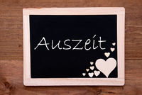 Balckboard With Wooden Heart Decoration, Text Auszeit Means Downtime