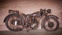 Vintage motor bike parked indoors