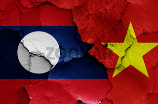 flags of Laos and Vietnam painted on cracked wall