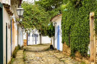 Streets of cobblestone and old historical houses in colonial style on the old and historic city of Paraty