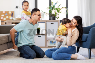 portrait of happy family sitting on sofa at home