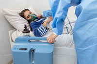 The doctor regulates the respirator so that the patient has the right amount of oxygen.
