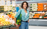 happy smiling woman with food in reusable net bag