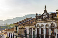 Facades of houses in colonial architecture in an old street in the city of Ouro Preto