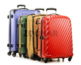 Four suitcases isolated on white background