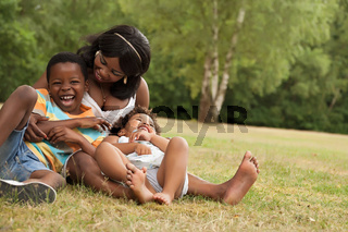 Mother plays with her children