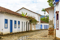 Streets of cobblestone with old colonial houses in colonial style on the old and historic city of Paraty