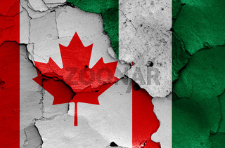flags of Canada and Nigeria painted on cracked wall