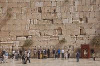 People praying at the Western 'Wailing' Wall of Ancient Temple in Jerusalem. The Wall is the most sacred place for all jews in the world