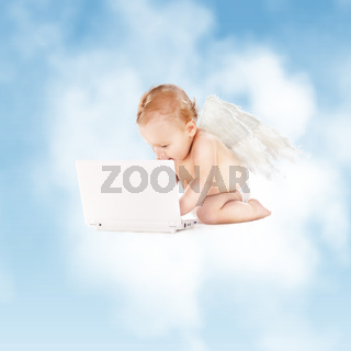 little angel with laptop computer