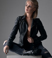 Model in leaher jaket and boots posing at studio