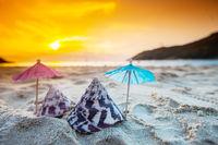Shells and paper umbrella