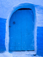 Closed blue door in Chefchaouen, Medina, Morocco