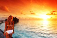 Woman at water villa at Maldives island