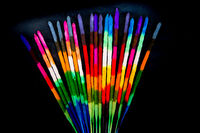 Colored and fragrance handmade incense sticks on black background