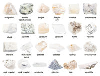 set of various unpolished white stones with names