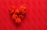 Red paper balls shaped as aheart