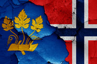 flags of Stavanger and Norway painted on cracked wall