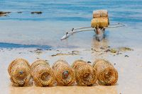 traditional malagasy fishing boat with trap on beach