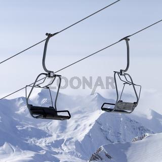 Ropeway at ski resort and mountains in fog