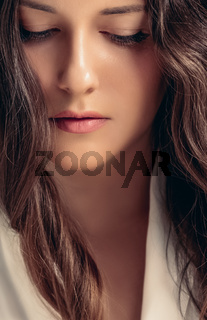Beautiful woman with calm and relaxed face expression, natural look and long wavy hairstyle, beauty portrait and female wellness